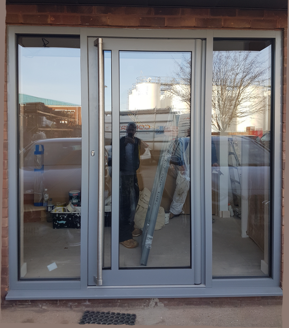 Thermal Commercial Door With Stainless Pole Handles.